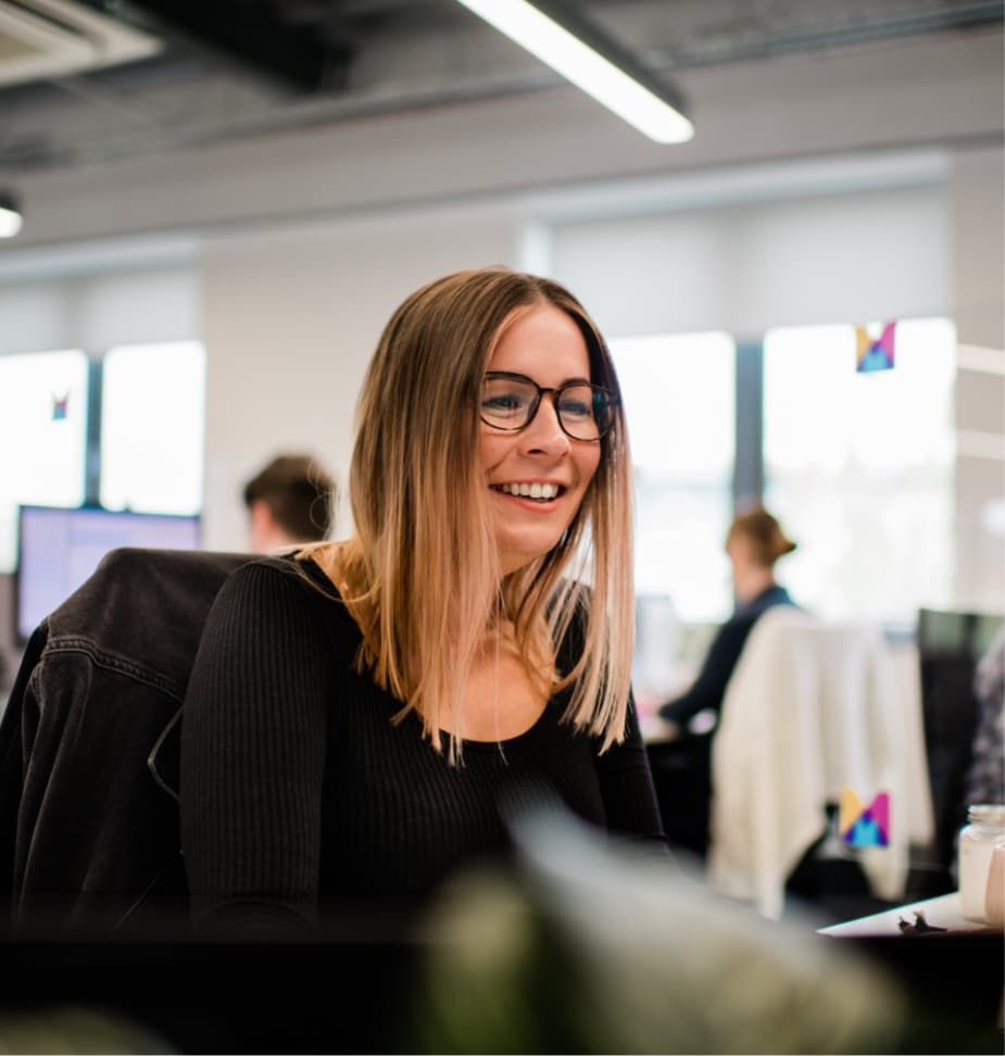 Person smiling at desk