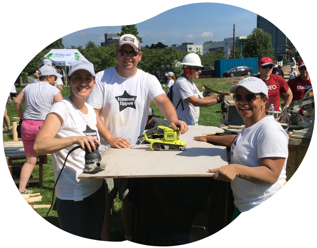 Smiling team working with tools
